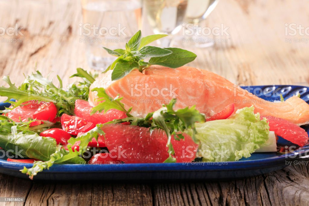 Salmon fillet and fresh salad royalty-free stock photo