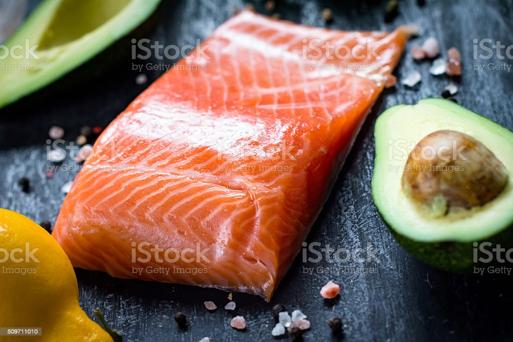 Salmon fillet, avocado, lemon and spices stock photo