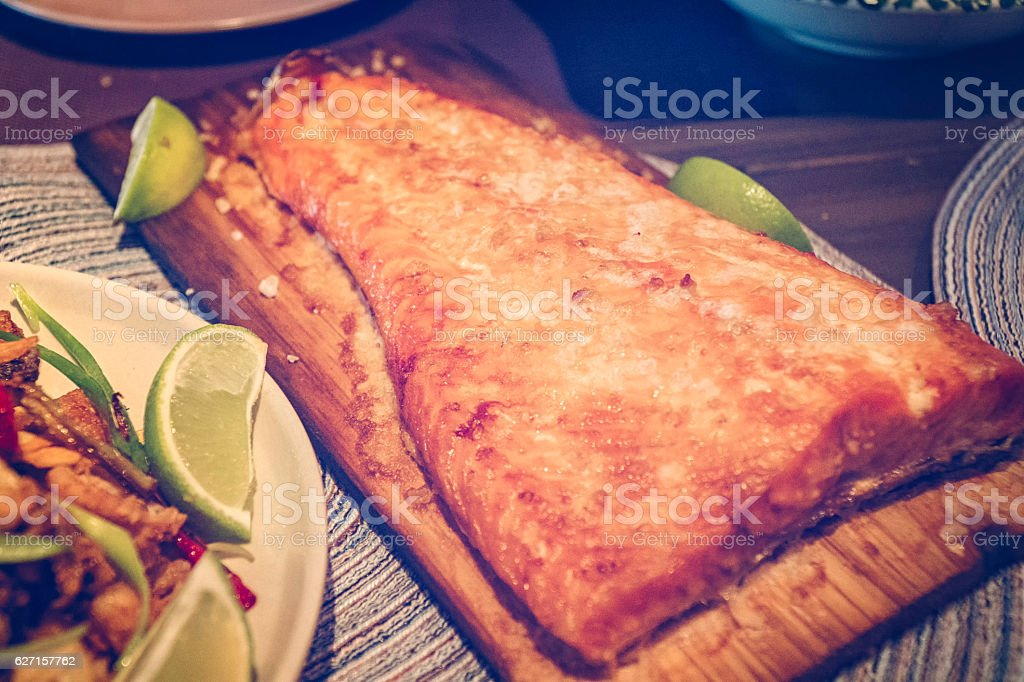 Salmon Fillet Grilled on Cedar Wood stock photo