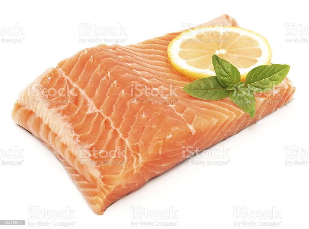 Salmon fillet isolated on white with lemon and herbs royalty-free stock photo