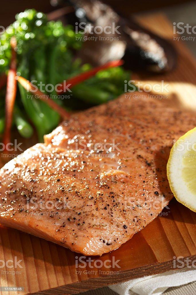 Salmon fillet on cutting board stock photo