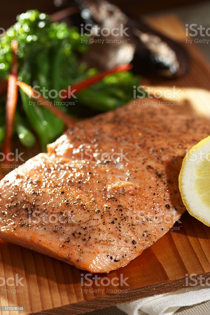 Salmon fillet on cutting board stock photo