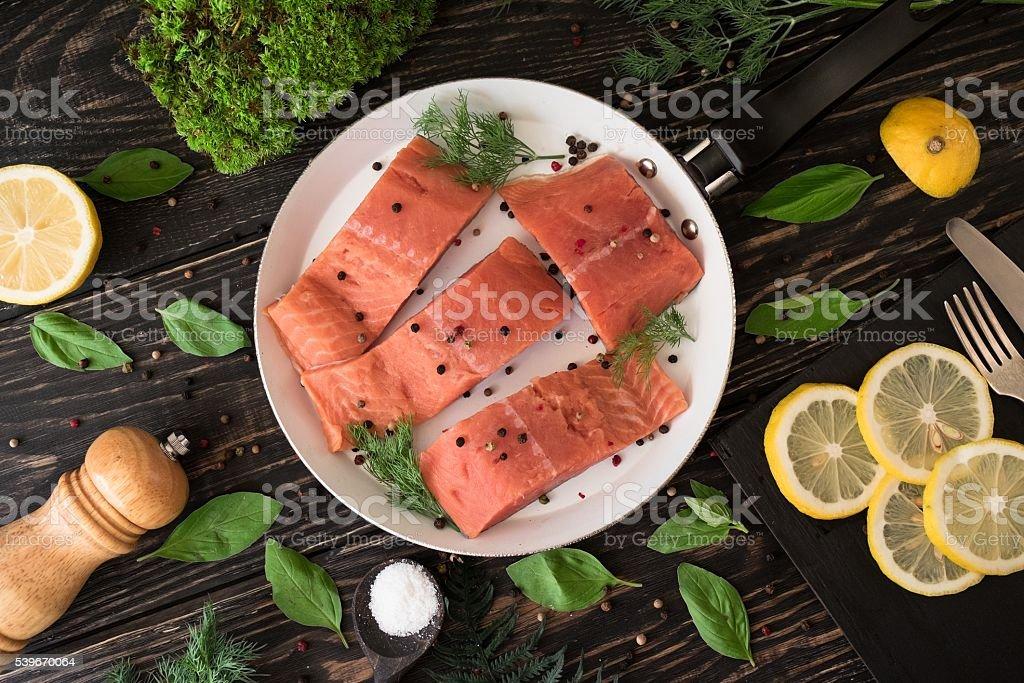 Salmon fillet on rustic kitchen table stock photo