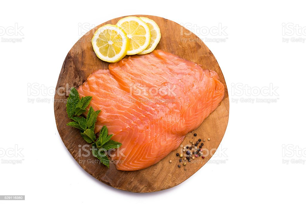 Salmon fillet on wooden board stock photo