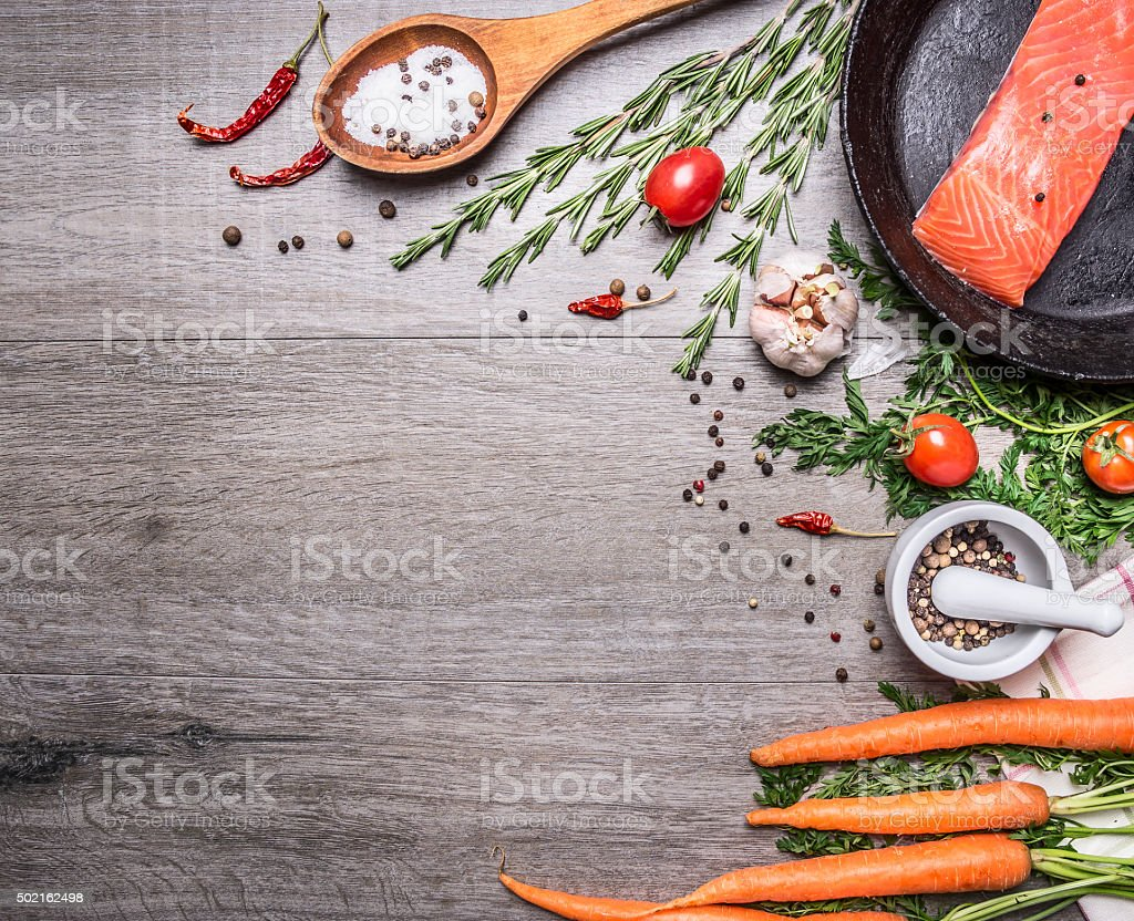salmon fillet  pan herbs,  on wooden rustic background top view stock photo