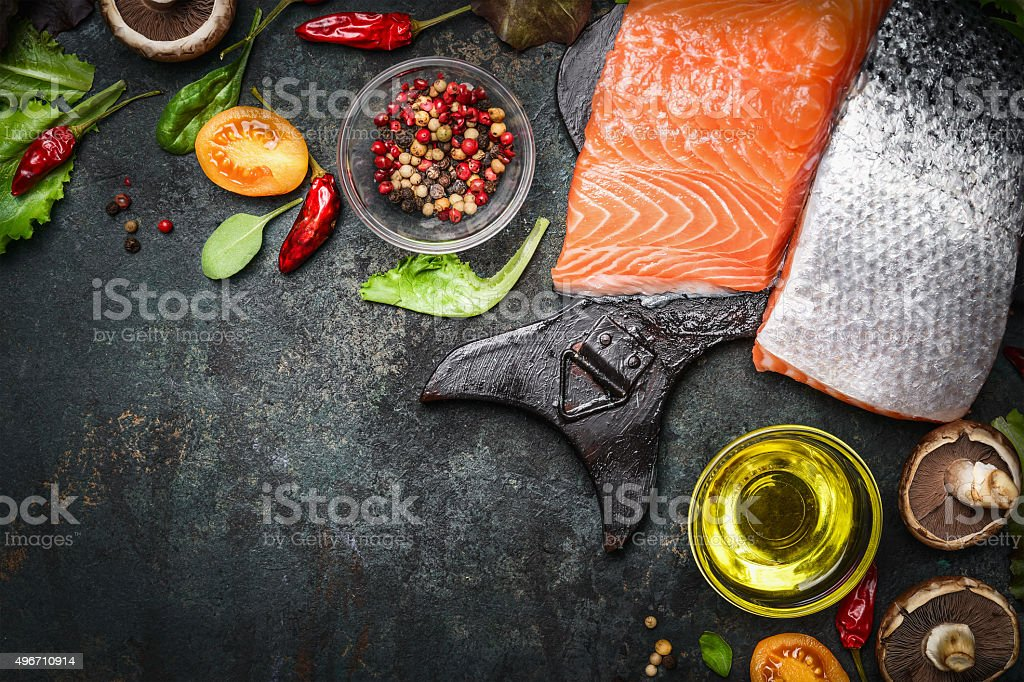 Salmon fillet with delicious ingredients for cooking stock photo