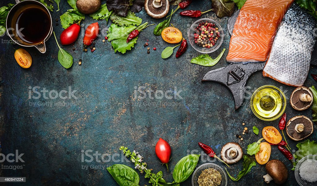 Salmon fillet with fresh ingredients for tasty cooking stock photo