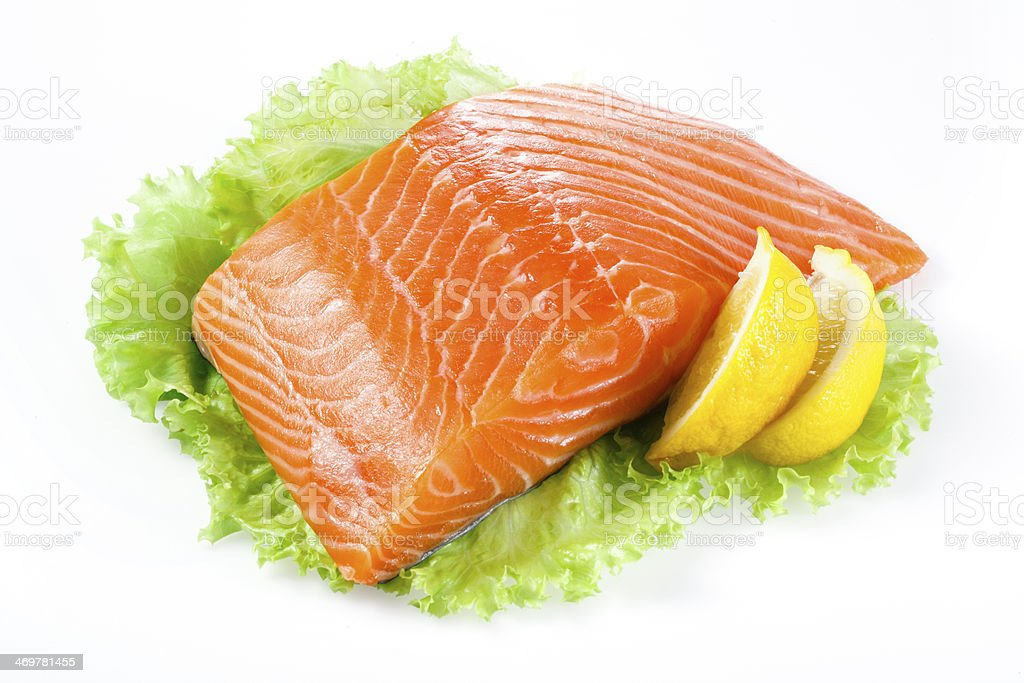 Salmon fillet with lemon isolated on white royalty-free stock photo