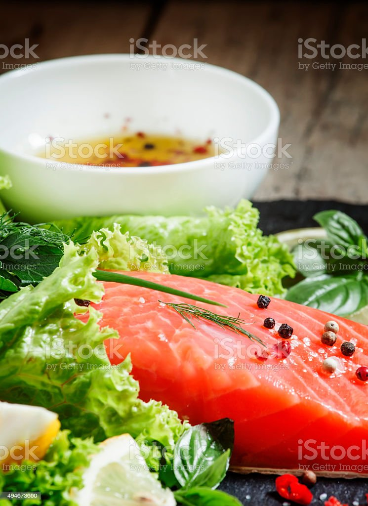 Salmon fillet with spices, herbs and seasonings stock photo