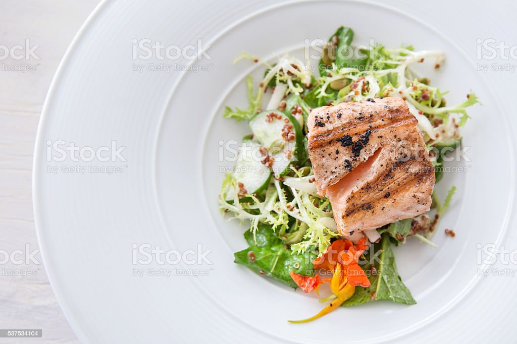Salmon fillet with vegetables stock photo