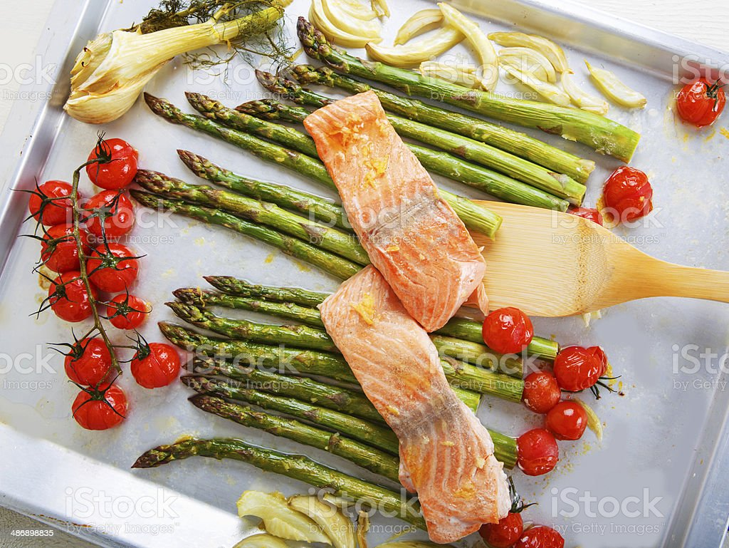 Salmon fish and green aspargus, cherry tomatoes, fennel royalty-free stock photo