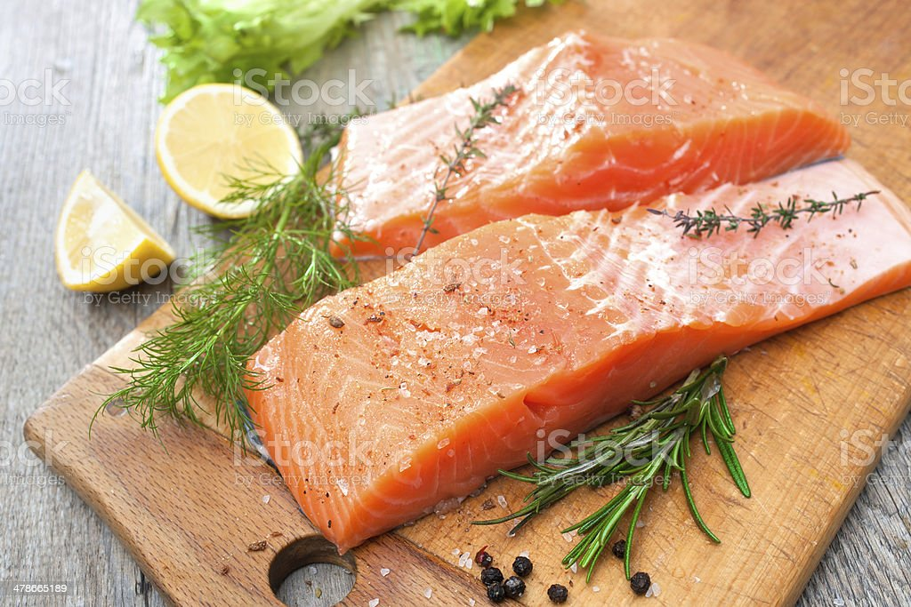salmon fish fillet with fresh herbs stock photo