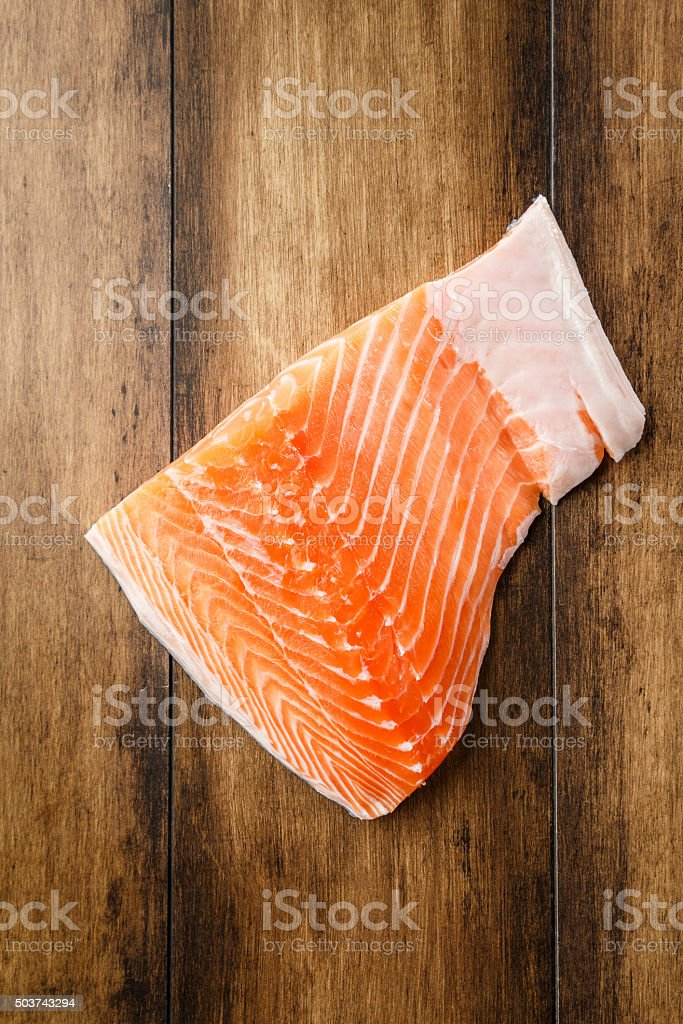 Salmon fish on ice on a wood table stock photo