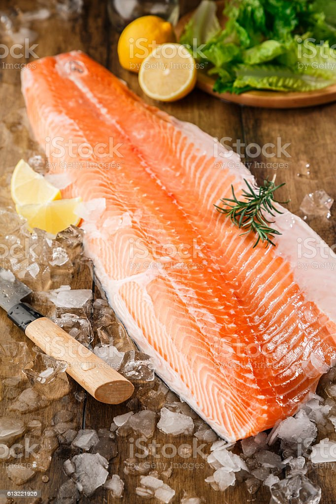 Salmon fish on the wooden table stock photo