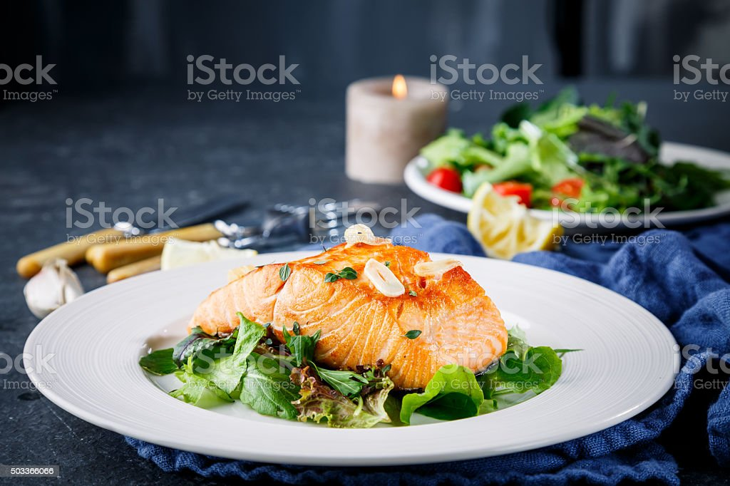 Salmon fish on white plate stock photo