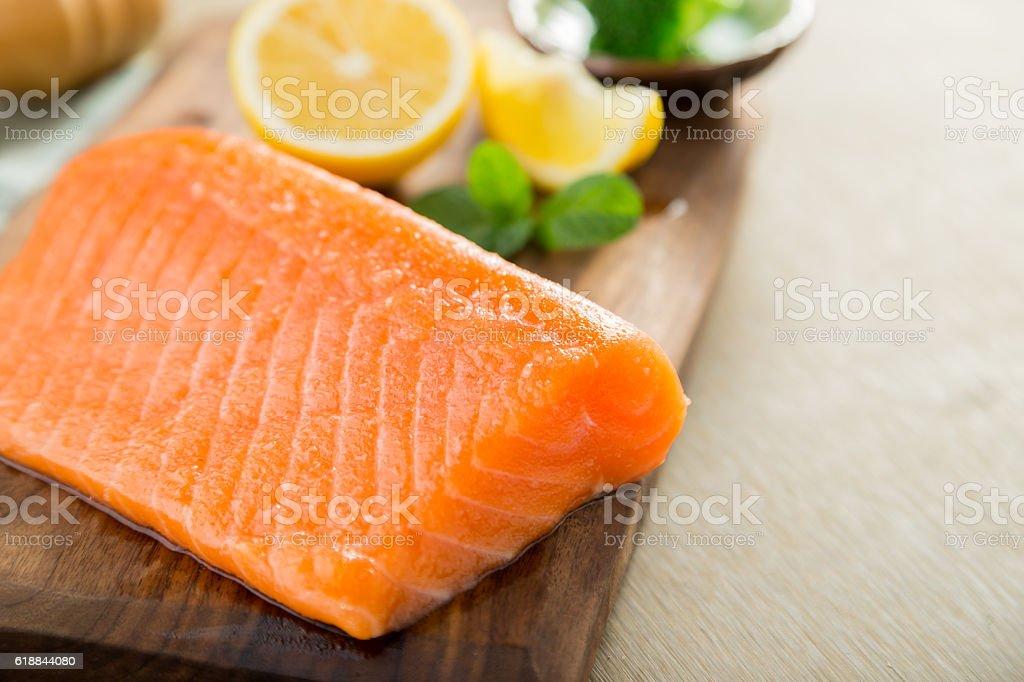 Salmon fish steck on the cutting board stock photo