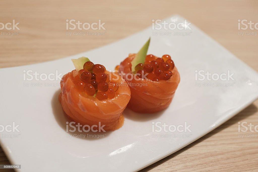 Salmon Ikura (Salmon eggs and avocado wrapped with raw salmon) stock photo