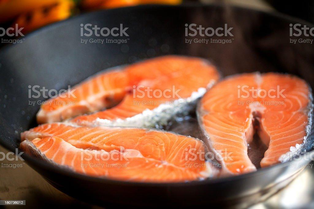 Salmon in a pan stock photo