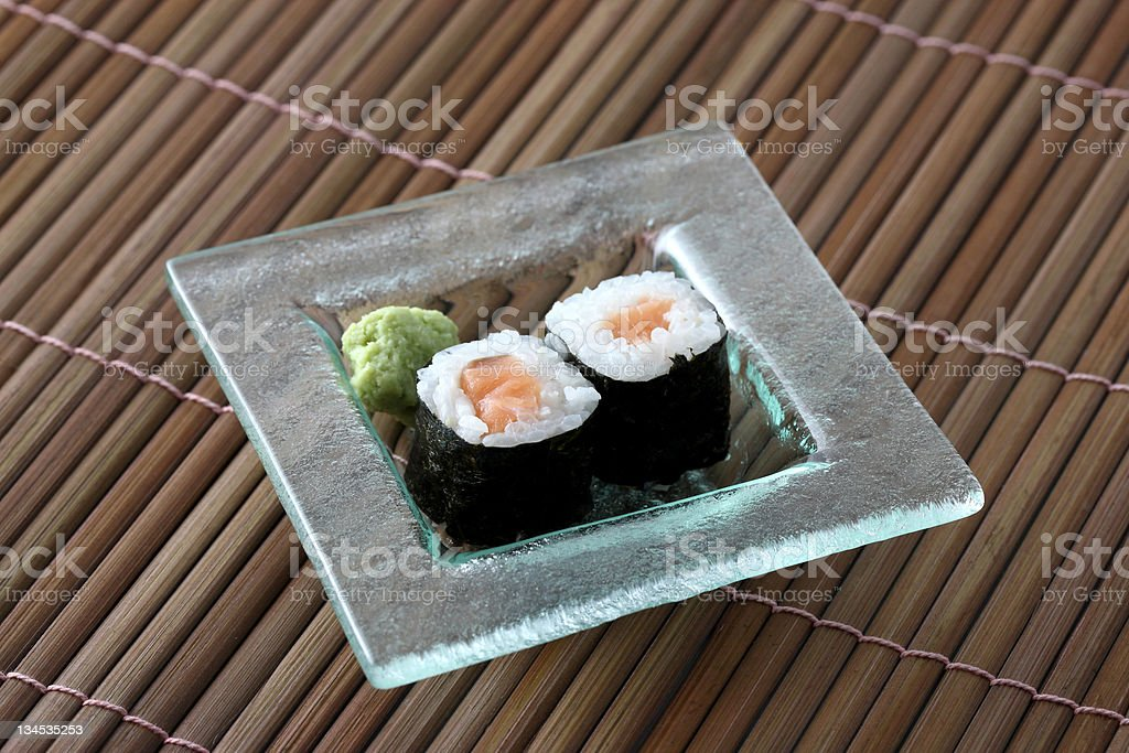 Salmon Maki sushi on wood background royalty-free stock photo