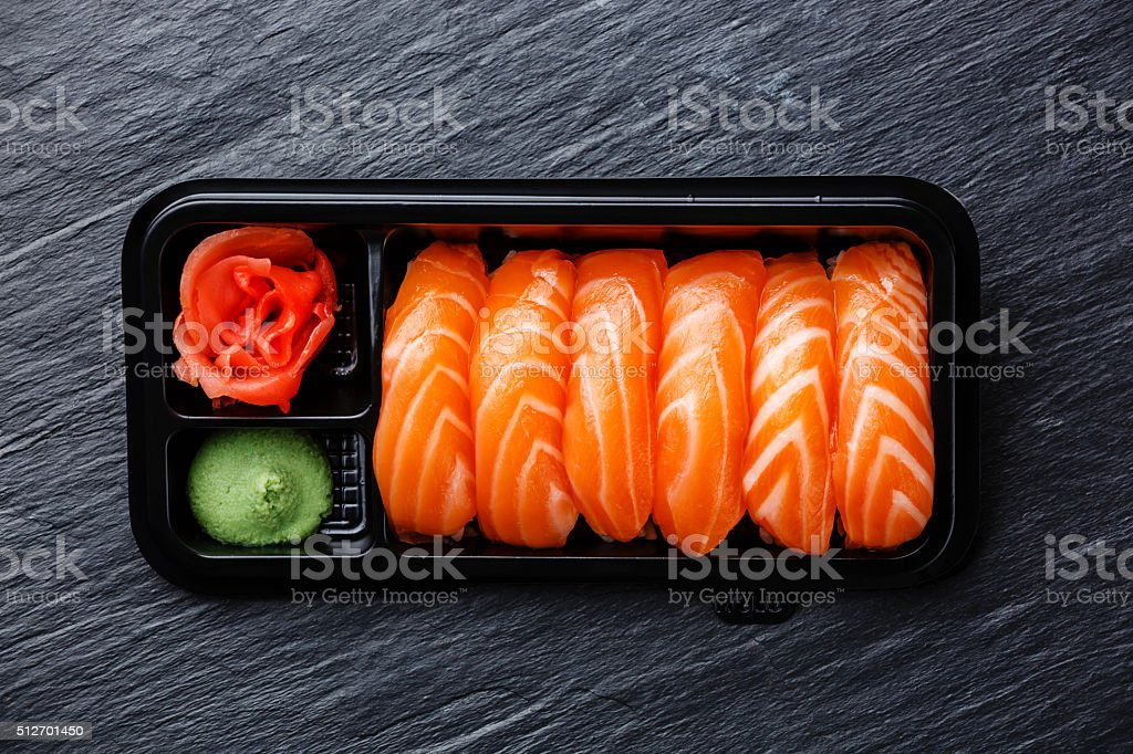 Salmon nigiri sushi in plastic box stock photo