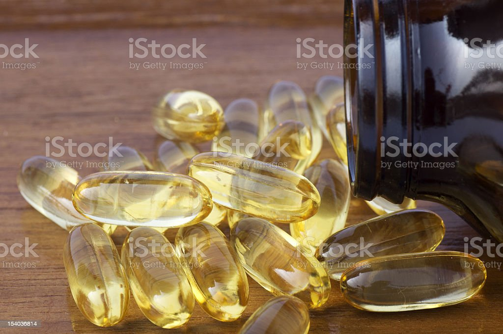 Salmon Oil and Evening Primrose Softgel Capsule stock photo