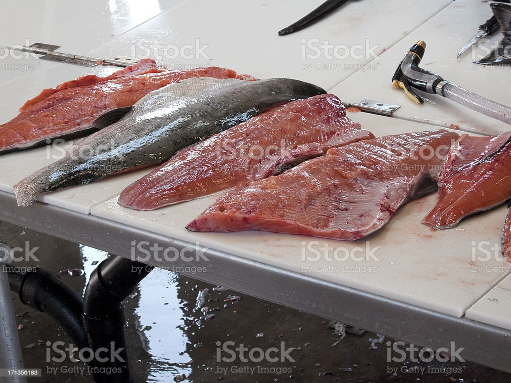 Salmon on Fish Cleaning Table stock photo