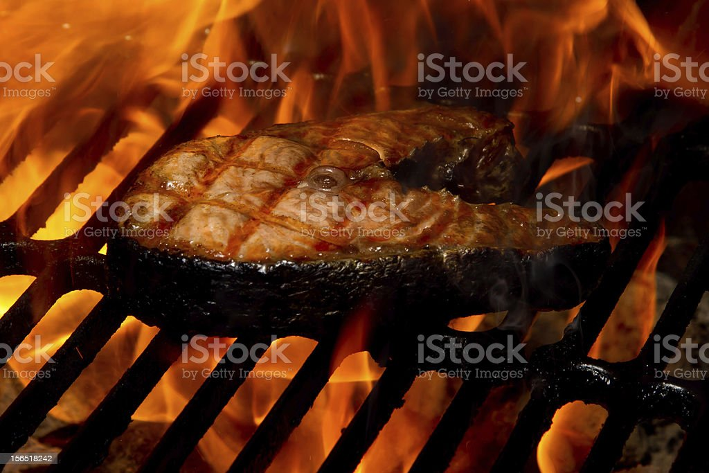 Salmon on Flaming Grill royalty-free stock photo