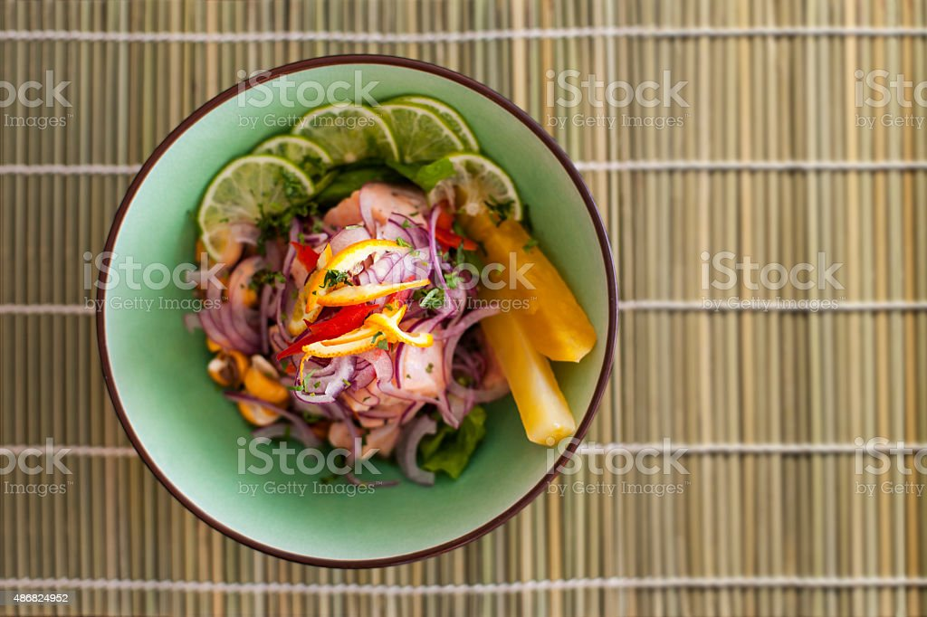 Salmon peruvian ceviche on bamboo mat stock photo