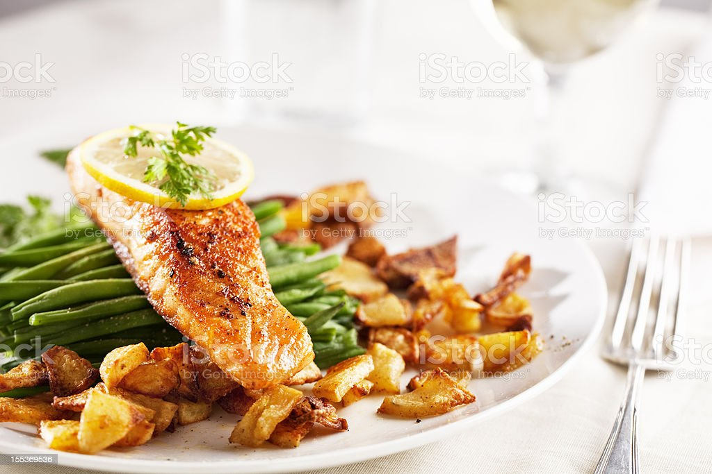 salmon, roast potatoes and vegetables royalty-free stock photo
