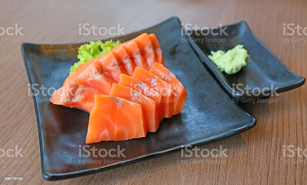 Salmon sashimi served with wasabi stock photo