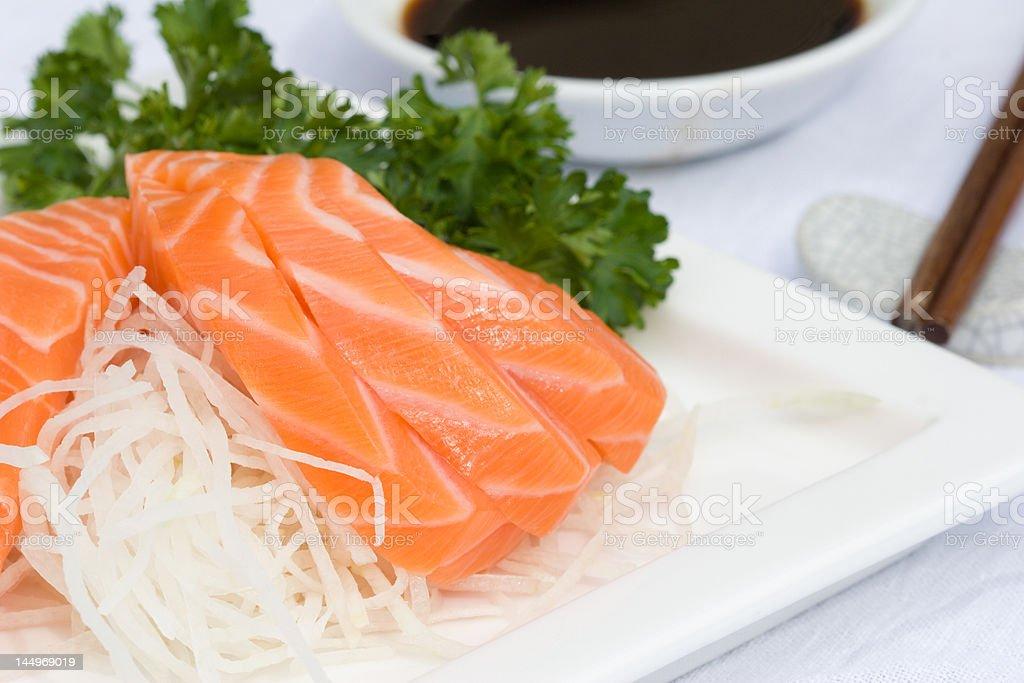 salmon sashimi with garnish, chopsticks, & soy sauce royalty-free stock photo