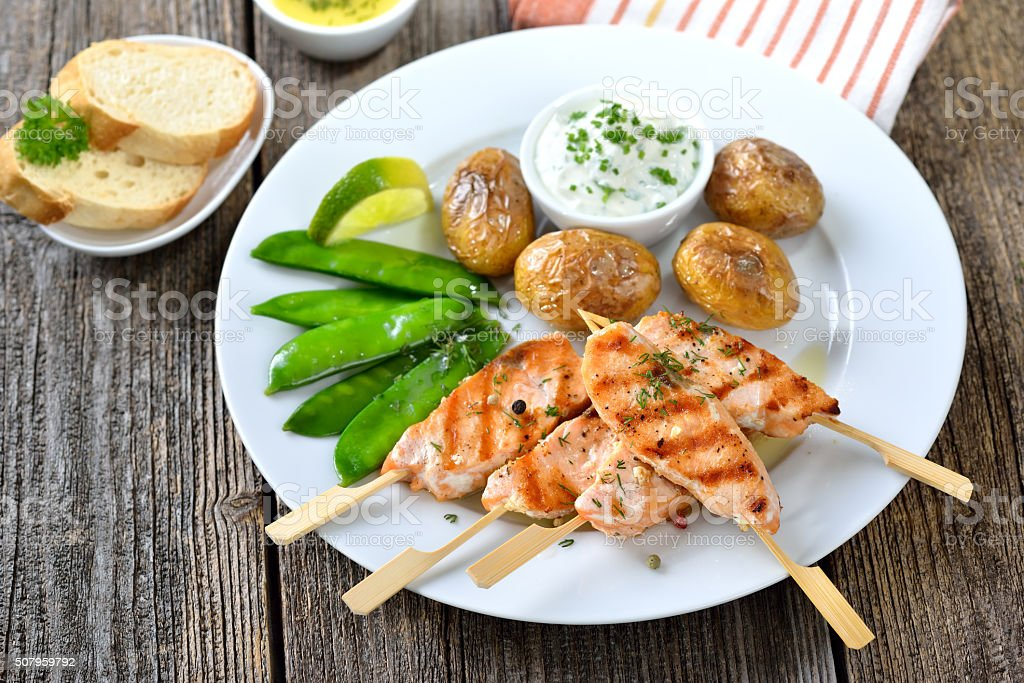 Salmon skewers stock photo
