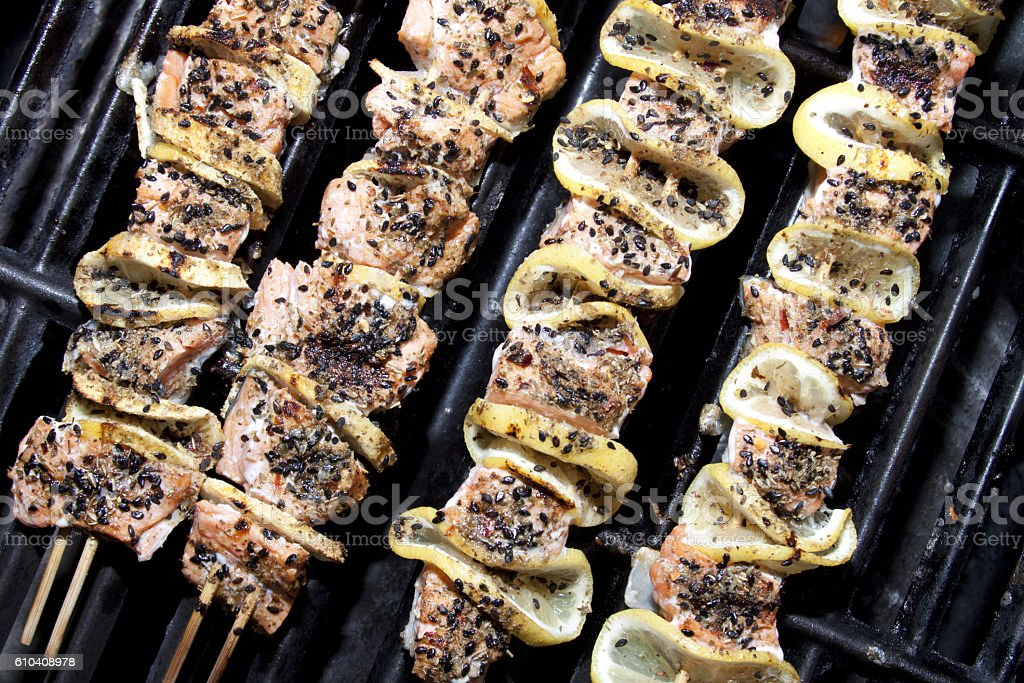 Salmon skewers stock photo