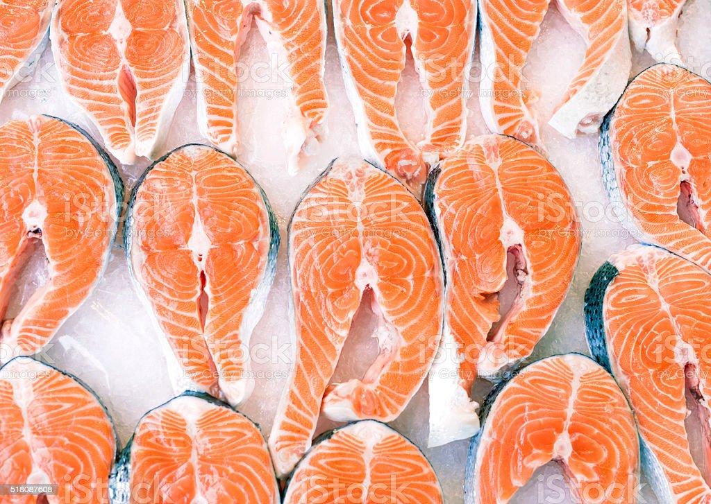 salmon slices on ice stock photo