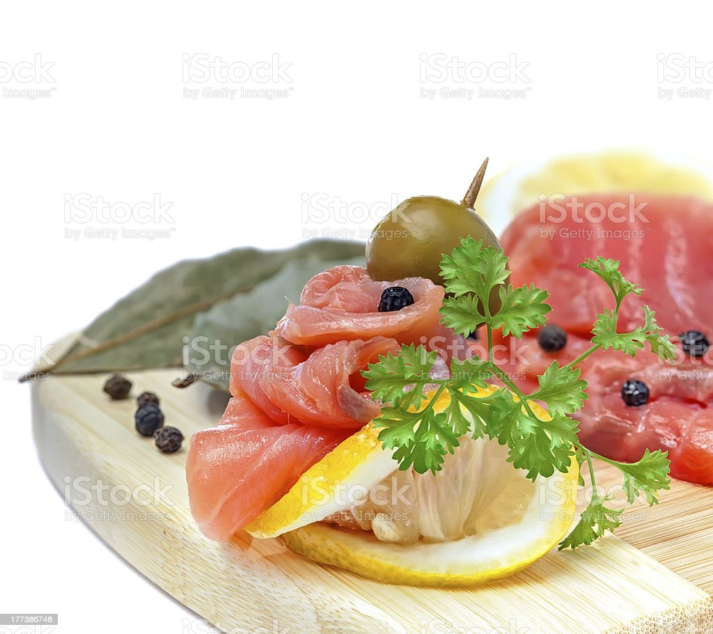 Salmon snack on the wooden board royalty-free stock photo