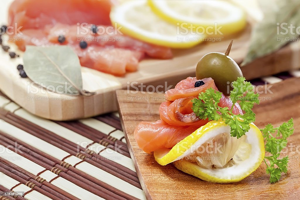 Salmon snack on the wooden plate royalty-free stock photo