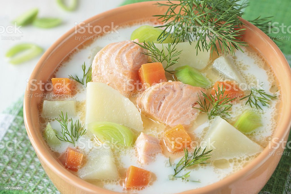 Salmon soup with cream and potatoes royalty-free stock photo