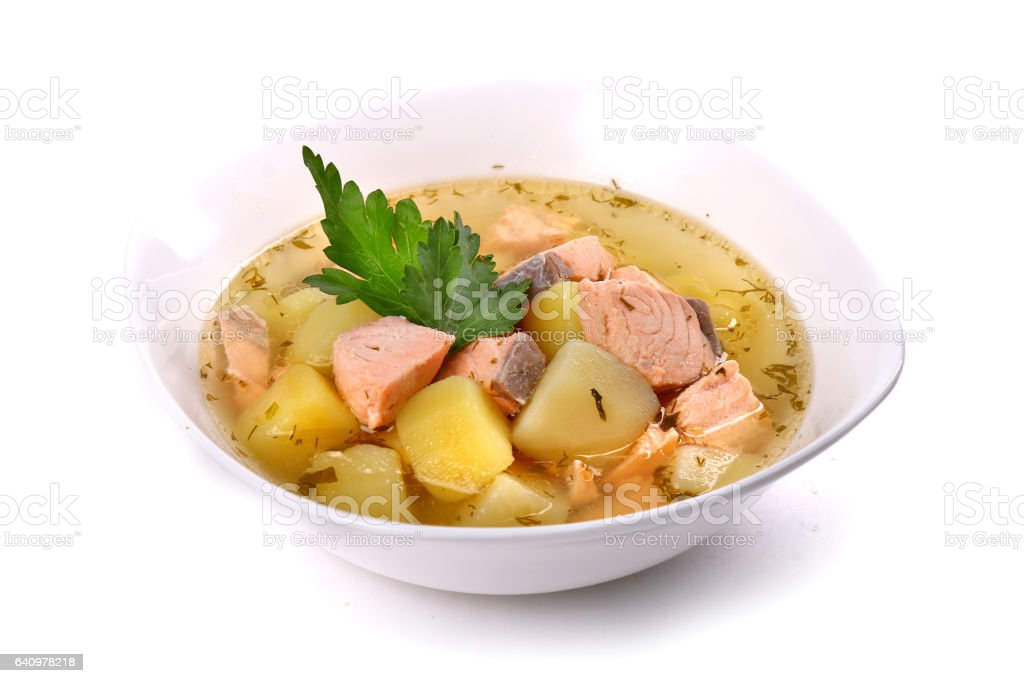 Salmon soup with potatoes and parsley stock photo