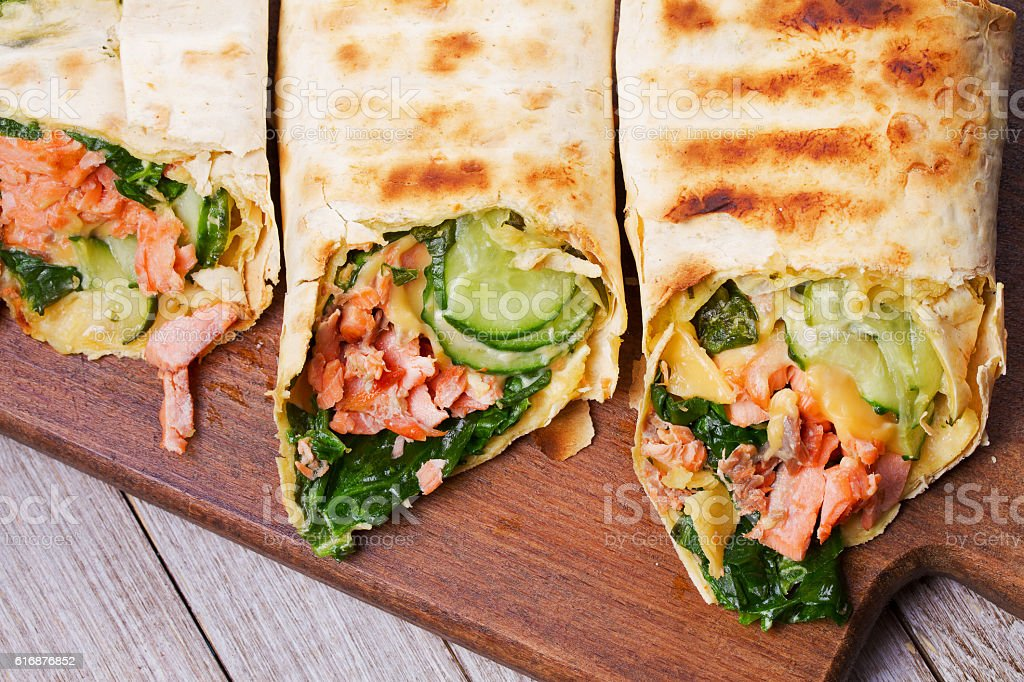 Salmon, Spinach, Cheese and Cucumber Burritos stock photo