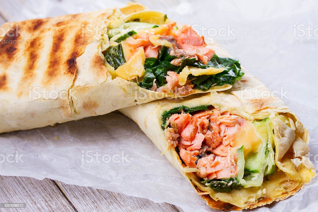 Salmon, Spinach, Cheese and Onion Burritos stock photo