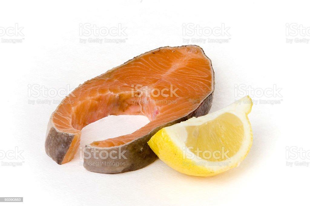 Salmon steak and lemon segment royalty-free stock photo