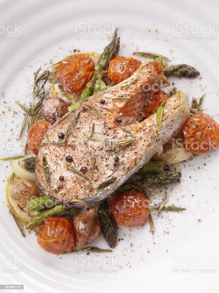 Salmon Steak on Roasted Vegetables royalty-free stock photo