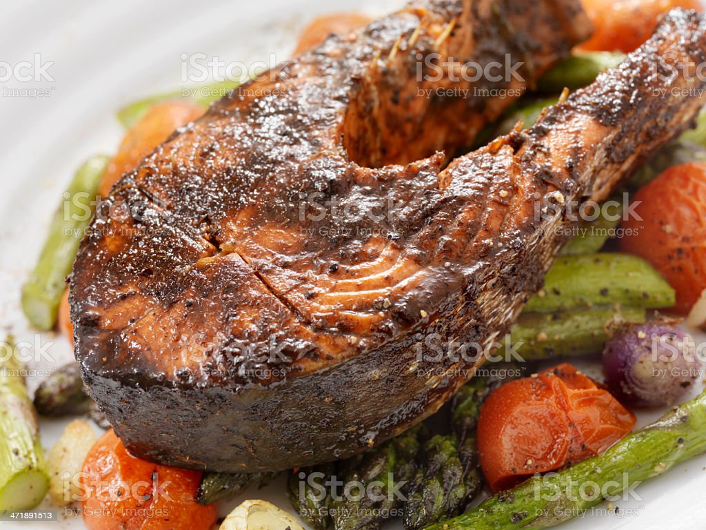 Salmon Steak on Roasted Vegetables royalty-free stock photo