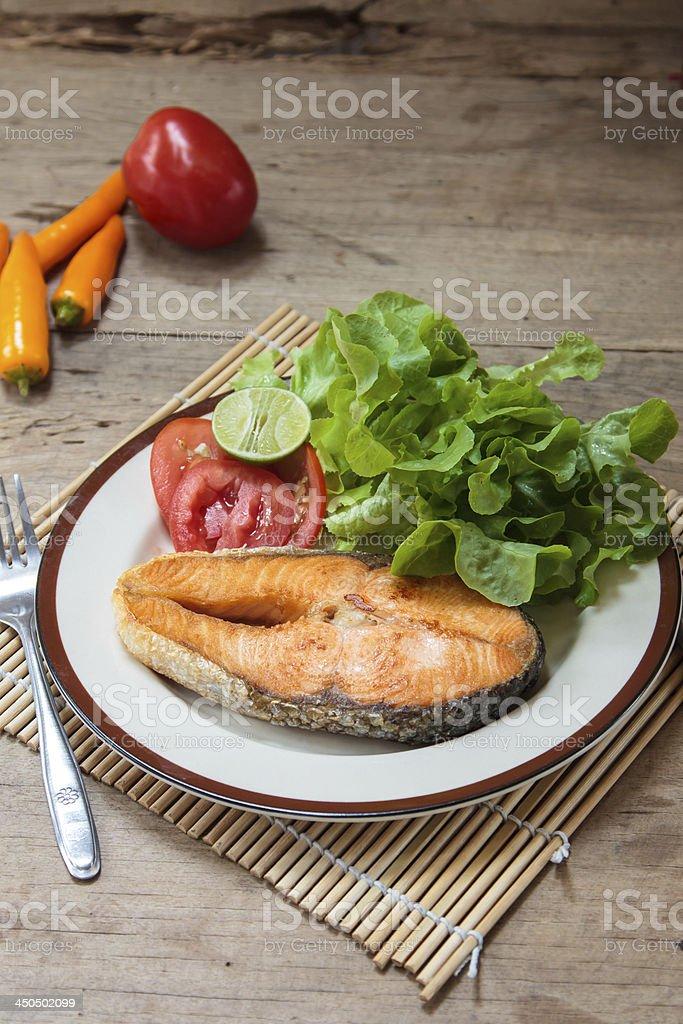 Salmon Steak on table wood royalty-free stock photo