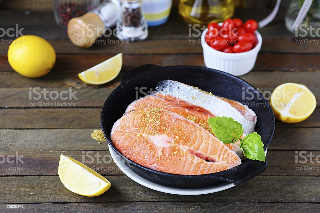 Salmon steak prepared for cooking royalty-free stock photo