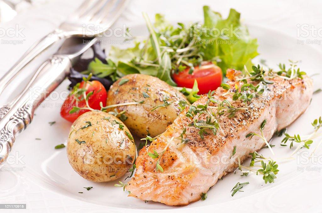 Salmon Steak roasted with Potatoes stock photo
