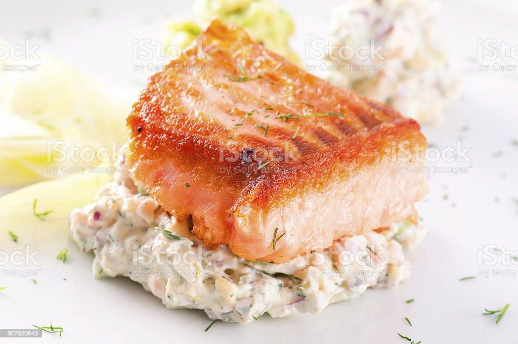 Salmon Steak with Avocado Tartar stock photo