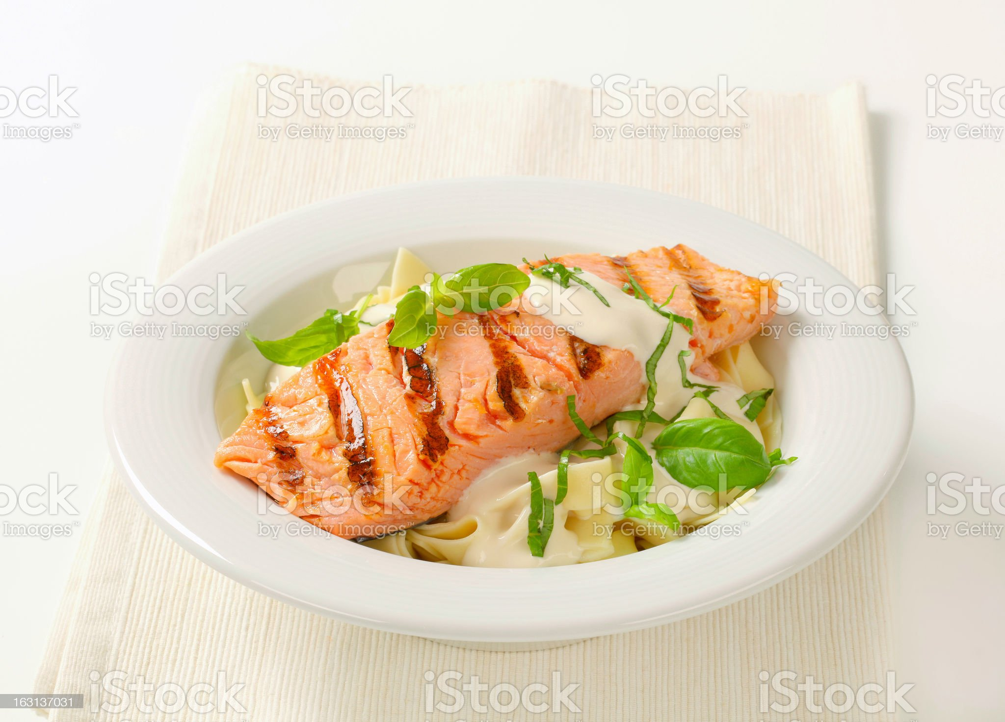 Salmon steak with basil and cream sauce royalty-free stock photo