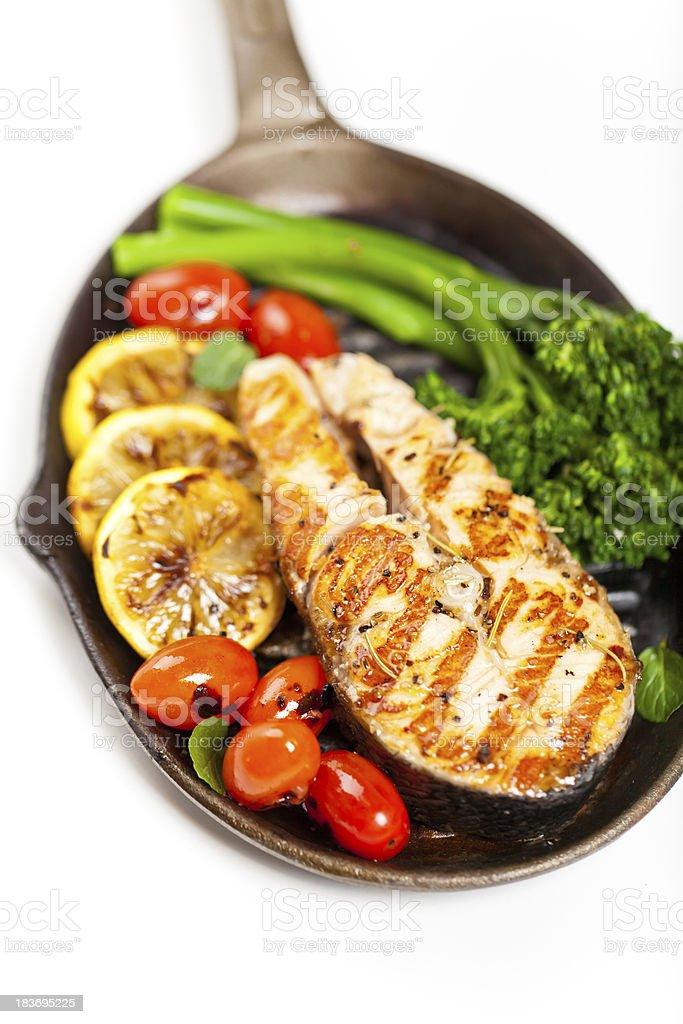Salmon steak with broccolini royalty-free stock photo