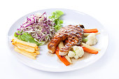 Salmon Steak with French fries and vegetables